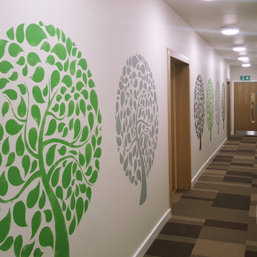 Wall stencils painted in three colours